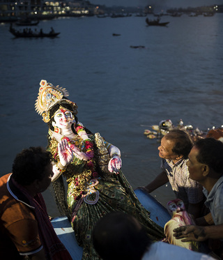 During the Durga Puja celebrations the inhabitants carried a Durga goddess statue from their colony to the Buriganga river. There they went out on the river by a boat to sacrifice the statue.